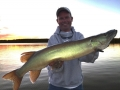 Steve's buddy Charlie Buhler with a nice early fall musky from shallow slop at sundown.