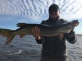 "Note the ""mackerel sky"" behind Steve's friend, Dave. The clouds started moving in and the fish bit."