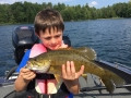 Ethan had a pretty good summer fishing for bass. Here he admires a smallmouth that he caught.
