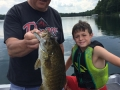 Steve with his grandson, Ethan, and a big smallmouth bass.