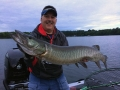 Clouds moving in and a terrific musky for Steve on a Swimmin' Dawg over 35 feet of water.
