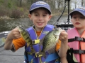 Steve's grandsons, Conner and Ethan, love to fish. (Ethan wouldn't hold any fish for this photo.)