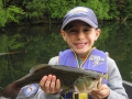 Grandson Conner with a nice largemouth bass.